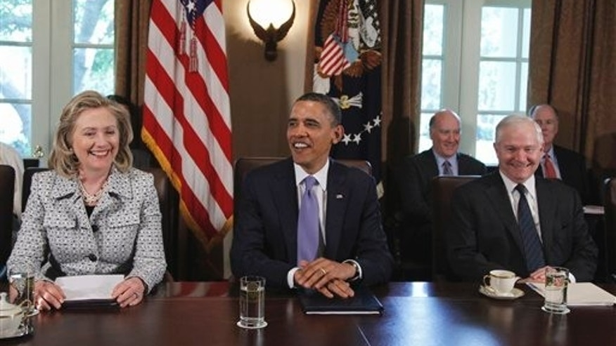 May 3: President Barack Obama, seated between Secretary of State Hillary Rodham Clinton and Defense Secretary Robert Gates at the start of a Cabinet meeting at the White House in Washington.