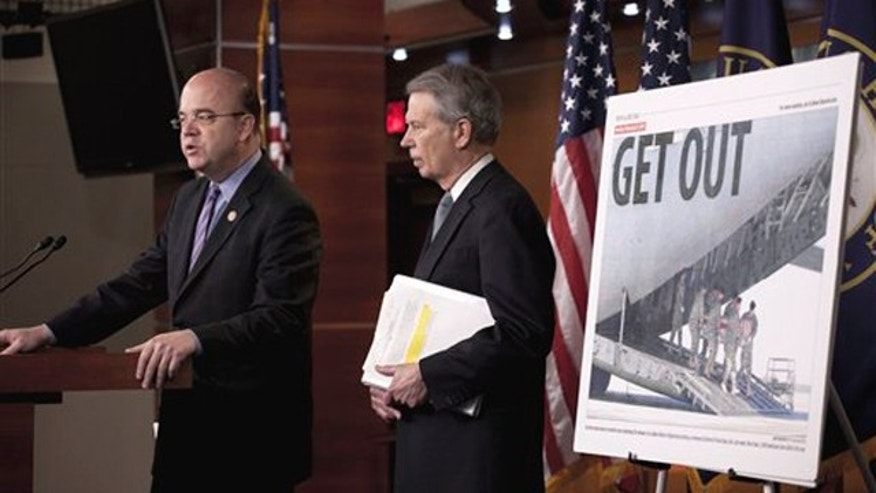 Rep. Jim McGovern, left, accompanied by Rep. Walter Jones, speak in Washington May 5, announcing their bipartisan bill calling for an exit strategy for U.S. forces from Afghanistan.