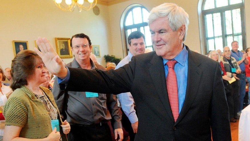 Former Speaker of the House Newt Gingrich is greeted to a standing ovation as he walks into the Historic Courthouse, Saturday, April 16, 2011, in Lawrenceville, Ga. Gingrich spoke during the GOP district convention at the courthouse. (AP Photo/Gwinnett Daily Post, Jonathan Phillips)