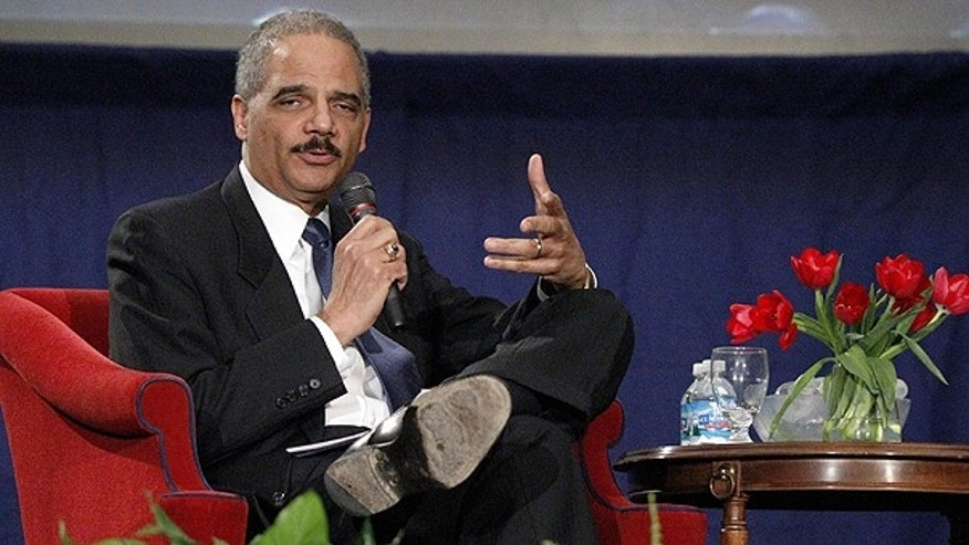 Feb. 23: Attorney General Eric Holder answers a student's question after his speech commemorating the 100th anniversary of the Duquesne University School of Law in Pittsburgh.