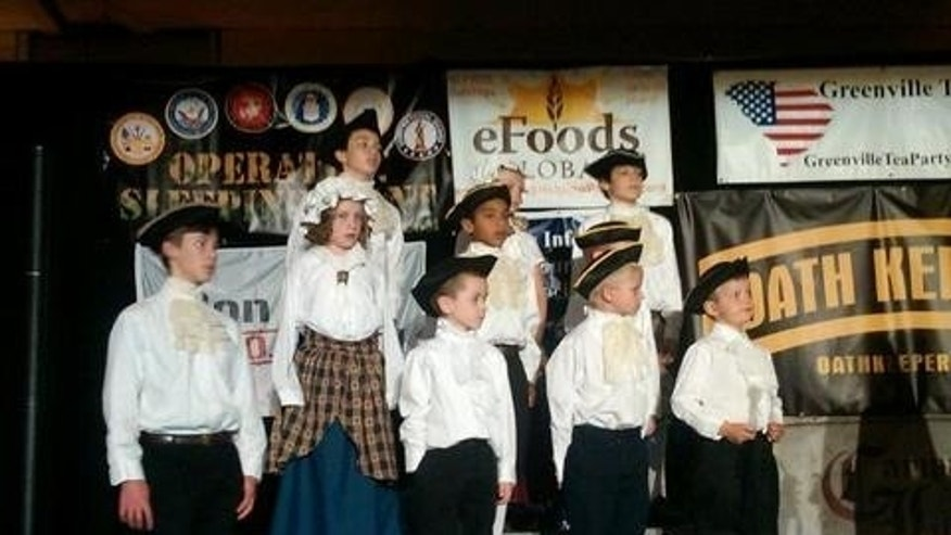 "Children in period costume sing patriotic songs at the Greenville Tea Party ""Freedom Rally."" (Fox News Photo)"