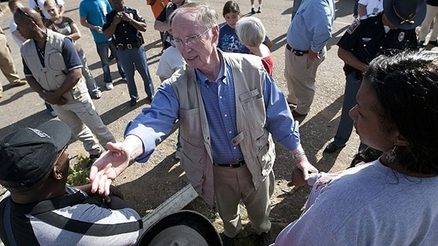 April 28: Alabama Gov. Robert Bentley visits with residents in Tuscaloosa, Ala., who lost their homes in a tornado strike.
