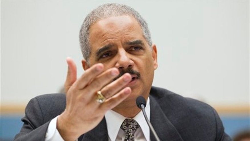 FILE: Attorney General Eric Holder testifies on Capitol Hill May 3 before a House Judiciary Committee oversight hearing.