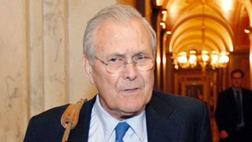Former Defense Secretary Donald Rumsfeld talks with a reporter on Capitol Hill May 3.