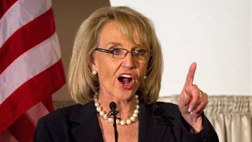 Arizona Gov. Jan Brewer speaks April 19 at the Governor's Volunteer Awards luncheon in Phoenix.