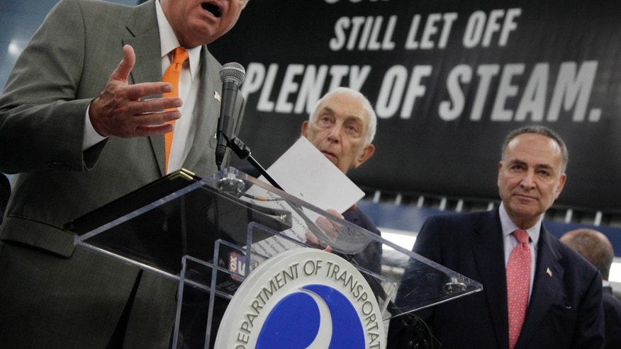 Monday: Sen. Charles Schumer, right, and Sen. Frank Lautenberg look on as U.S. Transportation Secretary Ray LaHood announces new rail funding at New York' Pennsylvania Station.