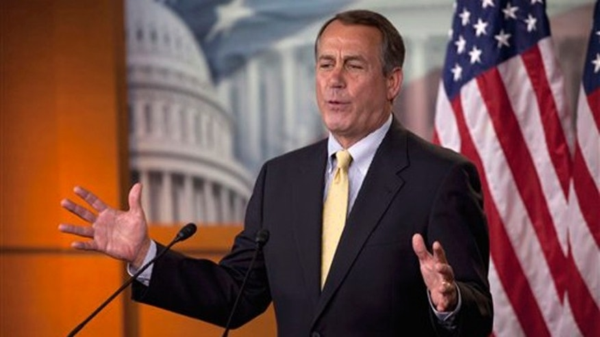 House Speaker John Boehner gestures during his weekly news briefing on Capitol Hill May 5.