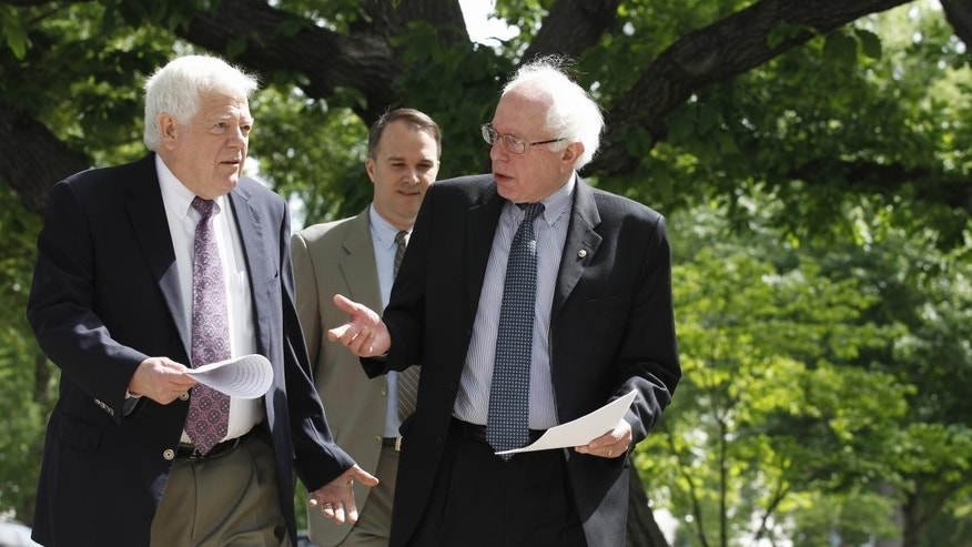 Sen. Bernie Sanders, I-Vt., right, talks with Rep. Jim McDermott, D-Wash., left, as they walk to news conference on Capitol Hill in Washington, Tuesday, May 10, 2011, to discuss their single-payer health care bills in the Senate and House. (AP Photo/Alex Brandon)