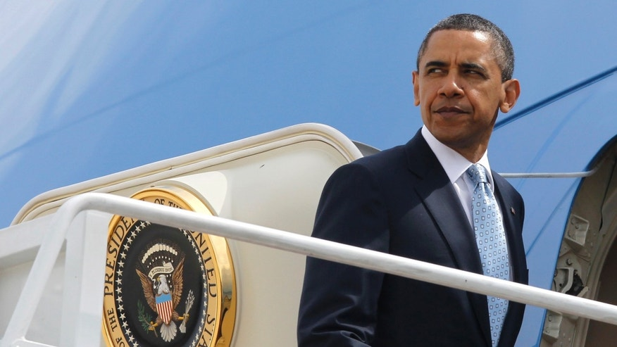 May 10: President Obama boards Air Force One at Andrews Air Force Base, Md.