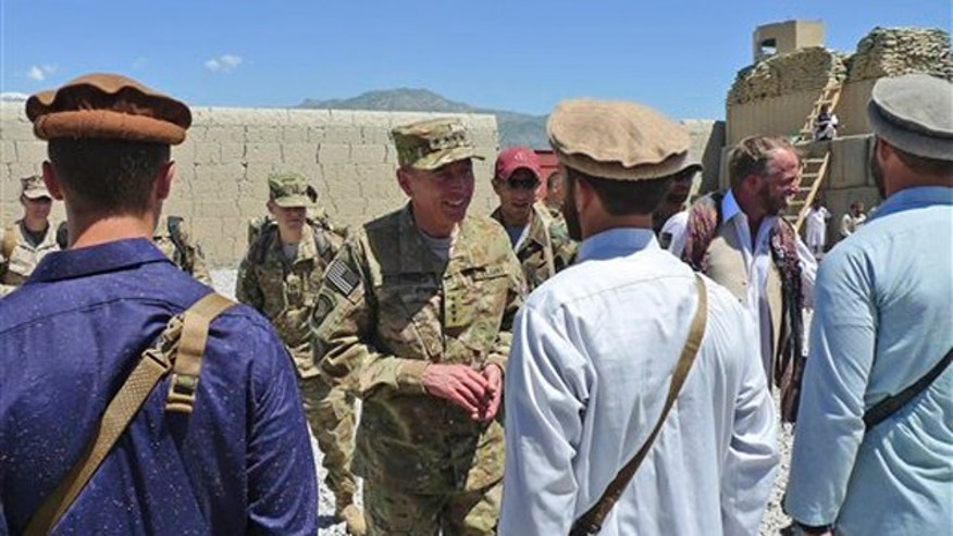 Gen. David Petraeus, center, commander of the NATO International Security Assistance Force (ISAF) meets with special forces in Kunar province in eastern Afghanistan May 8.