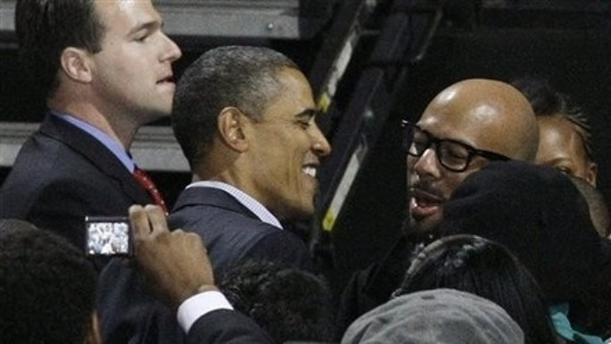 President Barack Obama, left, hugs rapper Common after a Moving America Forward rally for Democratic candidates Saturday, Oct. 30, 2010 in Chicago.(AP)