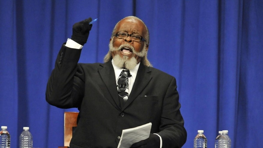 Jimmy McMillan, candidate for Rent is 2 Damn High party makes a point during the 2010 New York State Gubernatorial debate held at Hoftstra University in Hempstead, N.Y. (AP Photo/Kathy Kmonicek)