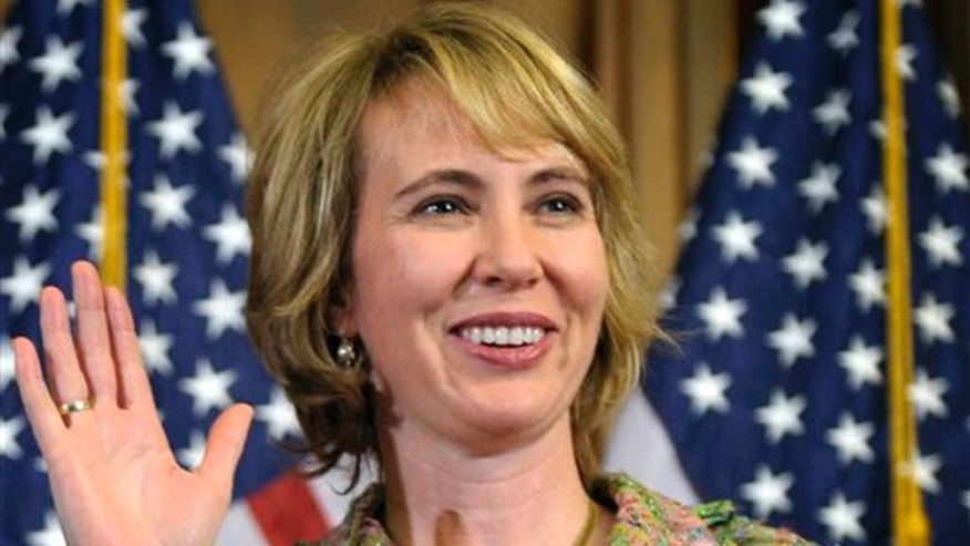 In this Jan. 5 file photo, Rep. Gabrielle Giffords takes part in a reenactment of her swearing-in on Capitol Hill.