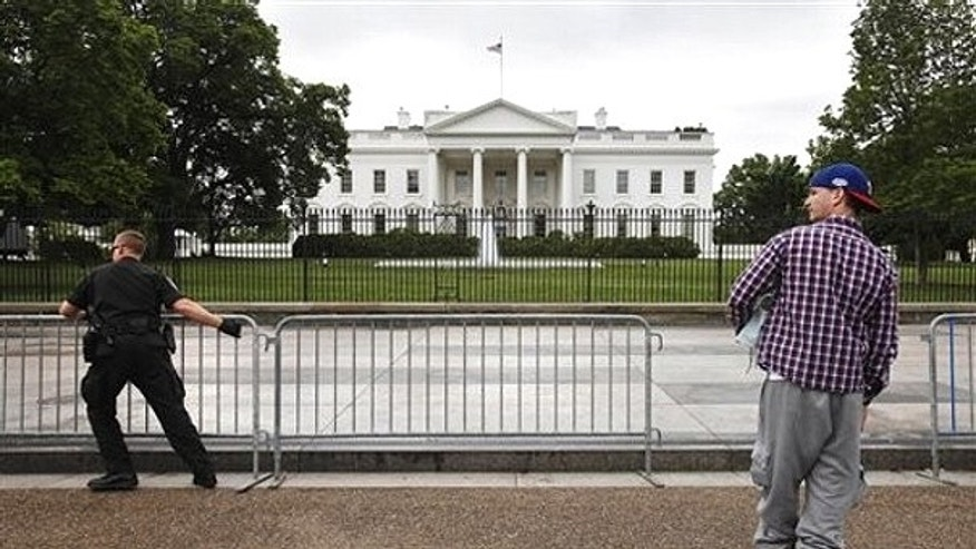 May 2: Sidewalk in front of the White House in Washington is reopened.