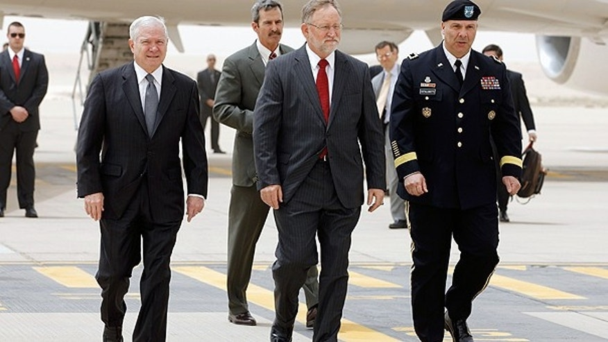 April 6: Defense Secretary Robert Gates, left, U.S. Ambassador to Saudi Arabia James Smith, center, and Maj. Gen. Robert Catalanotti, right, walk across the tarmac in Riyadh, Saudi Arabia.