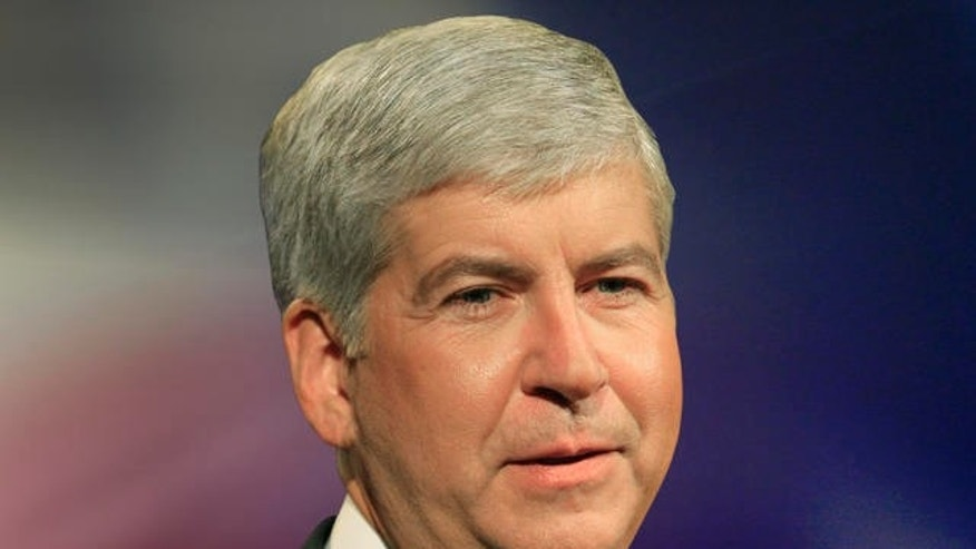 Republican Rick Snyder, debates Democrat Virg Bernero at the Detroit Public Broadcast studio in Wixom, Mich., Sunday, Oct. 10, 2010. A new poll released Sunday shows Snyder with a 20-point lead just three weeks before the Nov. 2 election. (AP Photo/Mandi Wright, Pool)