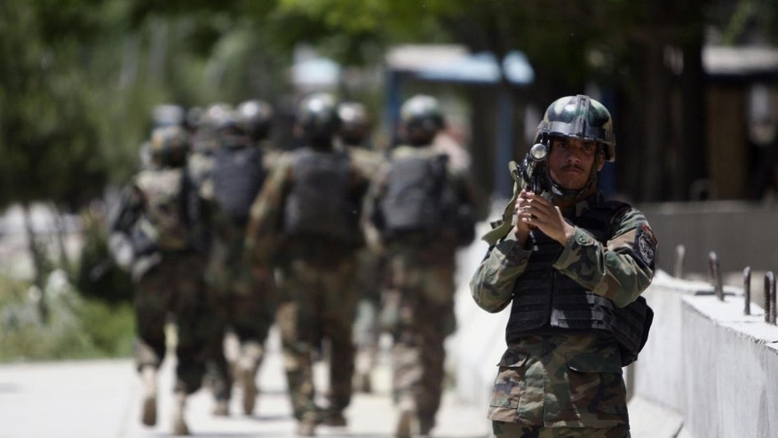 Afghan National Army soldiers arrive at the Kabul's main military hospital in Kabul, Afghanistan, Saturday, May 21, 2011. (AP Photo/Mustafa Quraishi)