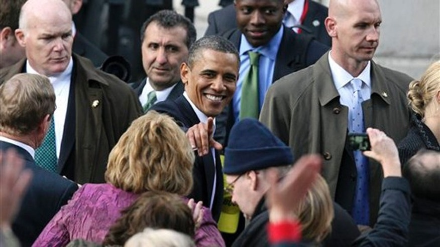 President Obama greets the crowd after addressing thousands of people in Dublin during his visit to Ireland May 23.