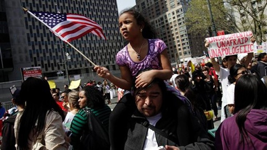 FILE - In this May 1, 2011 file photo, a  girl waves an American flag while participating in a rally for jobs and immigration rights in New York. Nearly every state in the union decided to tackle immigration on its own this year in the absence of any federal action on the issue. But an Associated Press review of the data found that as of Wednesday nearly all of the punitive measures failed. (AP Photo/Seth Wenig, File)