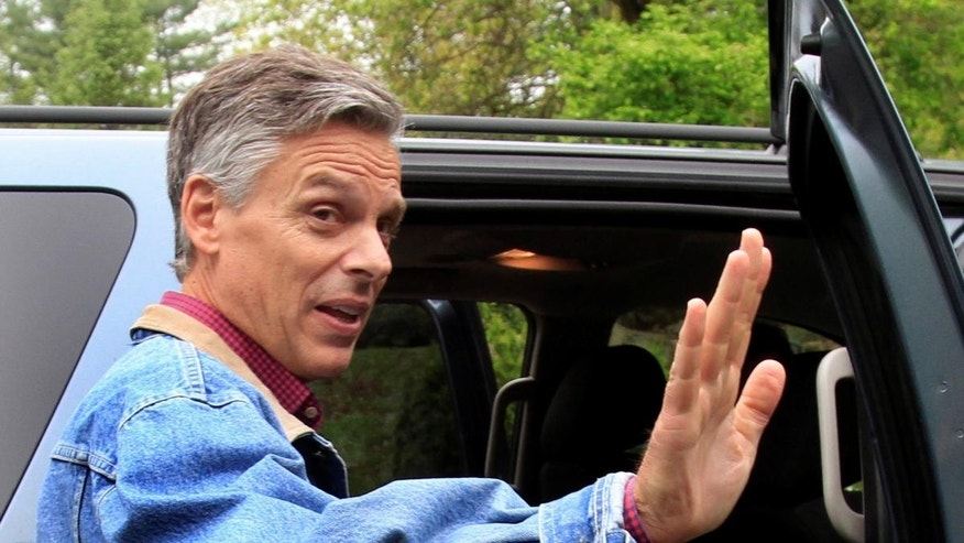 Former Republican Gov. Jon Huntsman, Jr., of Utah waves goodbye after greeting guests at a house party Monday, May 23, 2011 in Durham, N.H.. (AP Photo/Jim Cole)