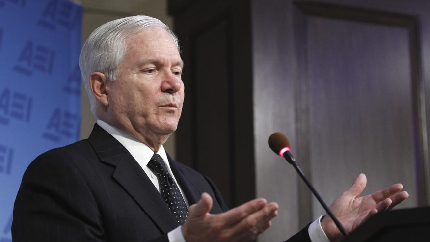 Defense Secretary Robert Gates gestures while speaking at the American Enterprise Institute for Public Policy Research in Washington, Tuesday, May 24, 2011. (AP Photo/Alex Brandon)