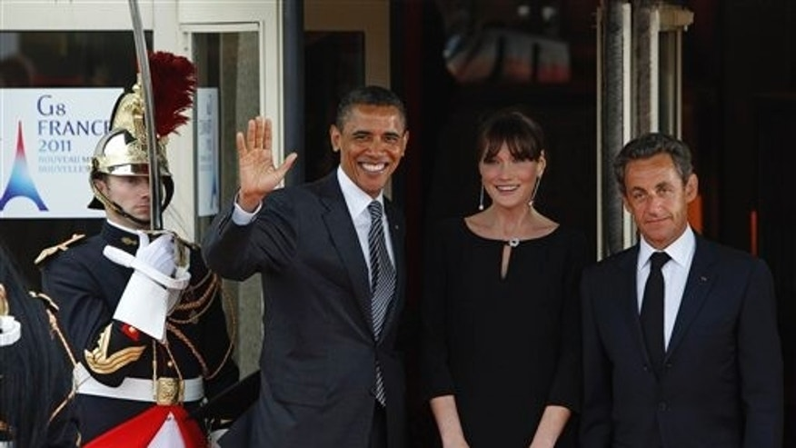 May 26: French President Nicolas Sarkozy and his wife Carla Bruni-Sarkozy welcome President Barack Obama during a dinner meeting for the G8 summit in Deauville, France.