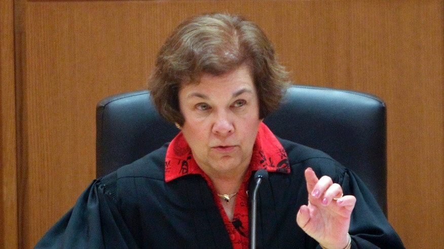 Friday: Judge Maryann Sumi listens to arguments during a hearing in Dane County Curcuit Court in Madison, Wis.