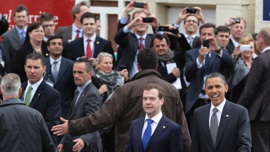 President Obama, right, and Russian President Dmitry Medvedev walk together as they arrive at the G8 Summit, in Deauville, France, Thursday, May 26, 2011. (AP)