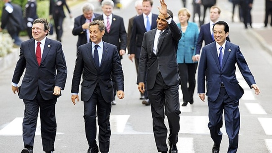 May 26: From left, European Commission President Jose Manuel Barroso, French President Nicolas Sarkozy, US President Barack Obama and Japanese Prime Minister Naoto Kan walk after a lunch meeting at the G8 summit in Deauville, France.