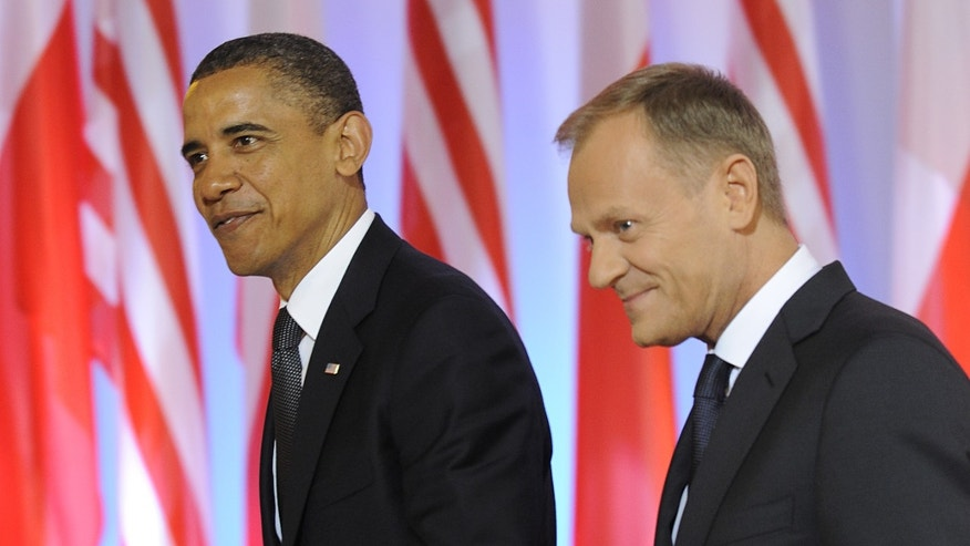 President Obama and Polish Prime Minister Donald Tusk,right, walk for talks at the Prime Minister's Chancellery in Warsaw, Poland, Saturday, May 28, 2011, on the second day of Obama's visit to Poland. (AP)