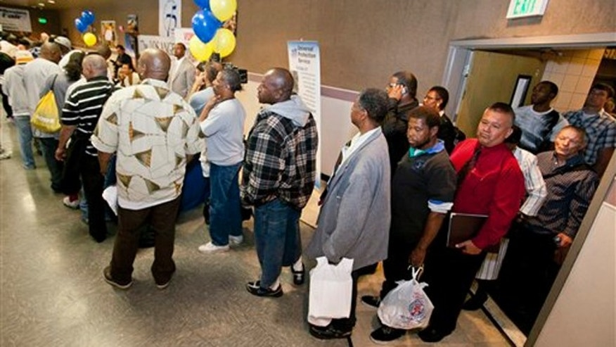 Job seekers line up at the 10th annual Skid Row Career Fair held at the Los Angeles Mission in downtown Los Angeles June 2.