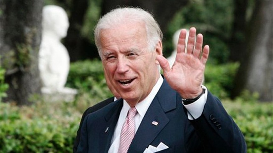 Vice President Joe Biden waves at Rome's Villa Doria Pamphili June 2.