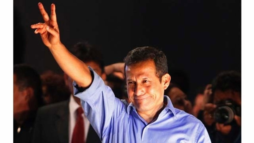 Presidential candidate Ollanta Humala gestures to supporters after the presidential runoff election in Lima, Peru, Sunday June 5, 2011.  Humala declared victory over rival candidate Keiko Fujimori in Peru's tightly contested presidential runoff, with official results incomplete but showing him winning. (AP Photo/Martin Mejia)