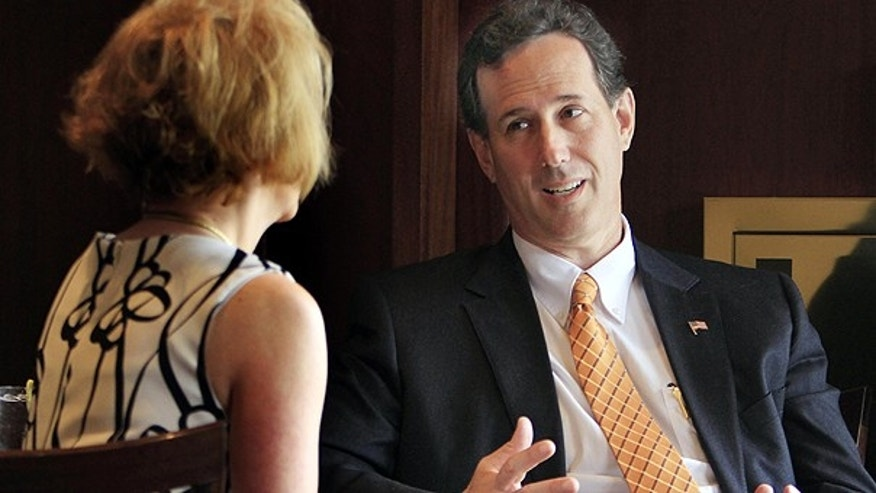 May 12: Possible 2012 presidential hopeful, former Republican U.S. Sen. Rick Santorum of Pennsylvania, talks with GOP activist Sue Carrol in Salem, N.H.