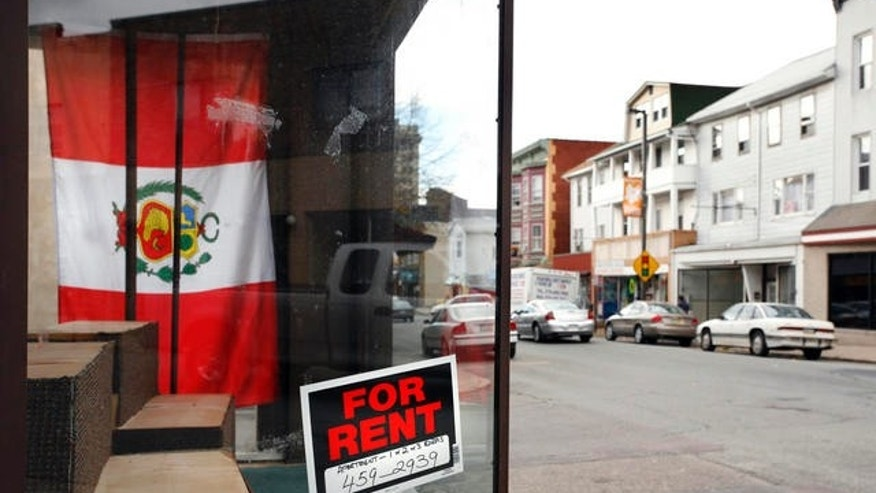 A storefront with a Peruvian flag in the window is shown for rent Thursday, Oct. 26, 2006 in Hazleton, Pa. This small hillside city in northeastern Pennsylvania has yet to enforce a tough, first-of-its-kind law targeting illegal immigrants, but evidence suggests that many Hispanics, illegal immigrants or otherwise, have already left. That has hobbled the city's Hispanic business district, where shops that flourished only six months ago have either closed or are struggling to stay open.(AP Photo/Steve Klaver)