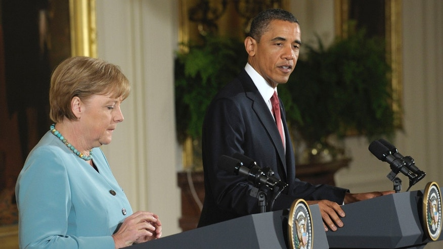 President Obama delivers opening remarks before a joint news conference with German Chancellor Angela Merkel, Tuesday, June 7, 2011, in the East Room of the White House in Washington. (AP)