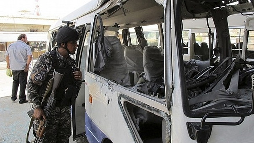 May 15: A policeman inspects a damaged bus after a rocket landed in central Baghdad. One person was killed and nine others wounded when nine Katyusha rockets landed in Baghdad's fortified Green Zone, where the U.S. embassy and Iraqi government officials' houses are located, and other central and southern areas of the Iraqi capital, the Baghdad security operations centre said.