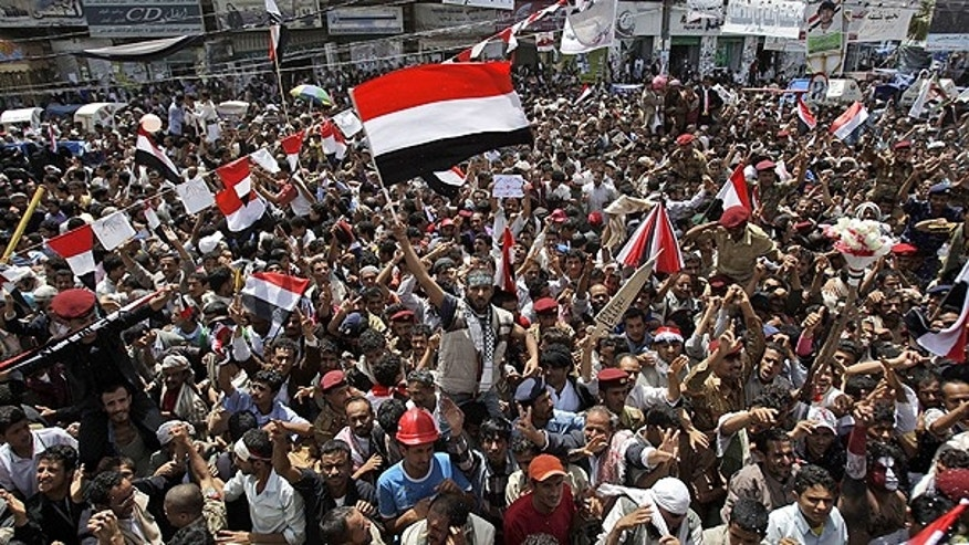 June 5: An anti-government protestor, center, waves his national flag while celebrating with others President Ali Abdullah Saleh's departure to Saudi Arabia, in Sanaa, Yemen. Thousands of protesters are dancing and singing in the Yemeni capital Sanaa after the country's authoritarian leader flew to Saudi Arabia to receive medical treatment for wounds he suffered in a rocket attack on his compound.