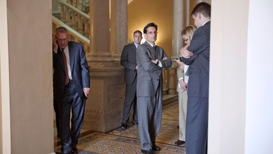 House Majority Leader Eric Cantor of Va., center, Senate Minority Leader Jon Kyl of Ariz., left, and others, are seen on Capitol Hill in Washington, Thursday, June 9, 2011, following a meeting on the debt ceiling. (AP)