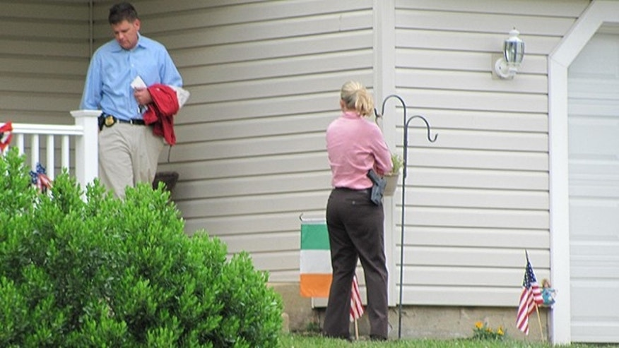 June 10, 2011: New Castle, Del., police leave the home of a 17-year-old girl who exchanged messages with Rep. Anthony Weiner in April through Twitter.
