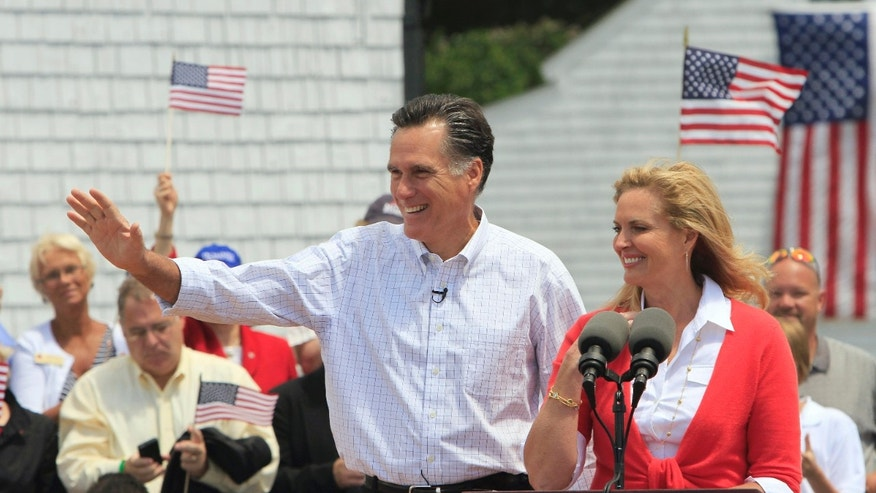 Former Massachusetts Gov. Mitt Romney, accompanied by his wife Ann, arrives to announce his 2012 candidacy for president, Thursday, June 2, 2011, in Stratham, N.H. (AP)