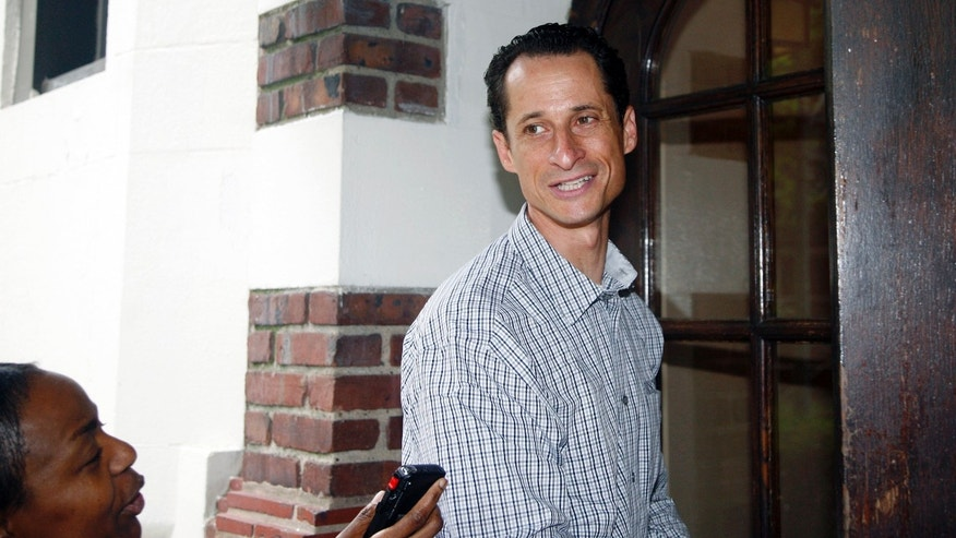 Saturday: Rep. Anthony Weiner, D-N.Y., enters his home in New York after running errands in his neighborhood.