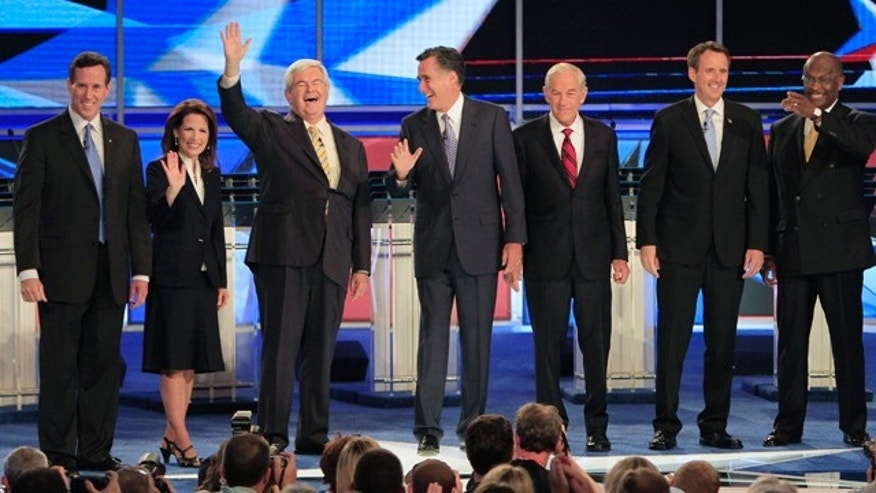 June 13, 2011: From left, former Pennsylvania Sen. Rick Santorum, Rep. Michele Bachmann, R-Minn., former House Speaker Newt Gingrich, former Massachusetts Gov. Mitt Romney, Rep. Ron Paul, R-Texas, former Minnesota Gov. Tim Pawlenty and businessman Herman Cain stand on stage before a Republican presidential debate in New Hampshire.