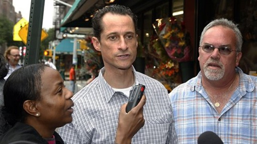 June 11: Rep. Anthony Weiner is interviewed as he walks down the street near his home in the Queens borough of New York.