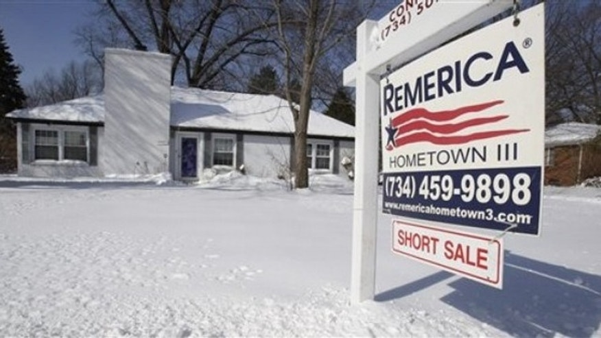 This Feb. 23 picture shows a foreclosed house for sale in the Detroit suburb of Southfield, Mich.