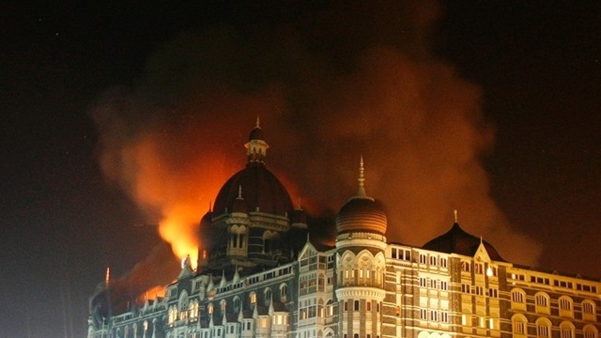 Nov. 27, 2008:  Smoke rises from the Taj Hotel in Mumbai. Gunmen killed at least 80 people in a series of attacks in India's financial capital.