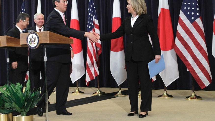 Tuesday: Secretary of State Hillary Rodham Clinton shakes hands with Japanese Foreign Minister Takeaki Matsumoto at a news conference at the State Department.