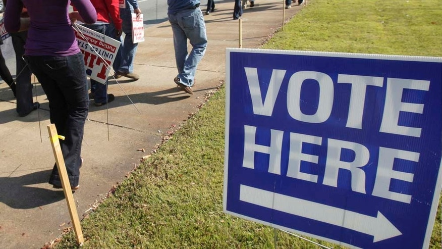 Campaign workers and volunteers walks past an early voting polling place in Little Rock, Ark., Monday, Oct. 18, 2010. (AP Photo/Danny Johnston)