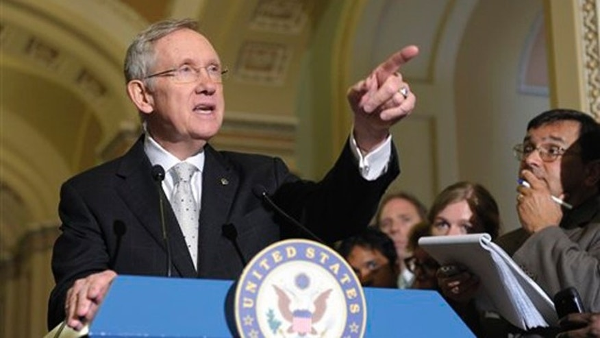 Senate Majority Leader Harry Reid speaks to reporters on Capitol Hill in Washington June 21.