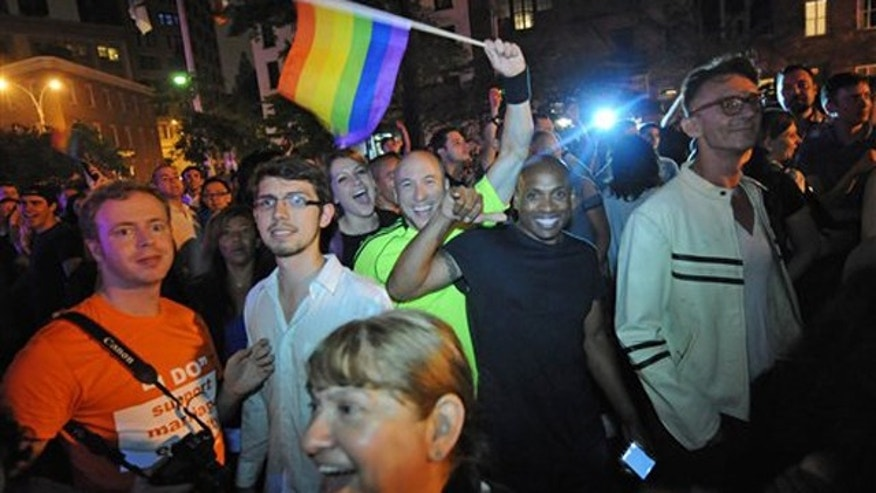Revelers celebrate in Manhattan's west village following the passing of the same sex marriage bill June 24 in New York.